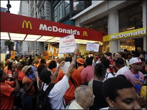 Protesting fast food workers demonstrate ou