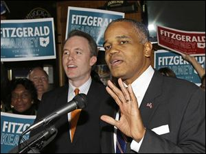 Ohio Democratic Senate Minority Leader Eric Kearney speaks at a rally in Cincinnati after Democratic gubernatorial contender Ed FitzGerald, left, introduced Mr. Kearney as his ru