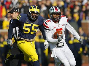 Ohio State's Braxton Miller runs past Michigan's Jibreel Black. Miller was named the Big Ten's quarterback of the year.