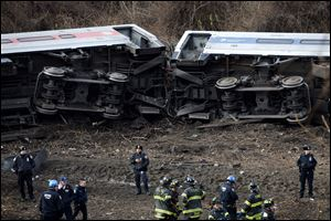Emergency personnel respond to the scene of a Metro-North passenger train derailment in the Bronx borough of New York Sunday.
