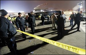 Kansas City, Mo. police work a crime scene in parking lot A outside Arrowhead Stadium, in Kansas City, Mo., after a person was killed Sunday.