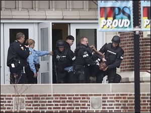 Toledo police remove Louis Stroude from Scott High School after a standoff.  He reportedly took a pellet gun into the school Monday.