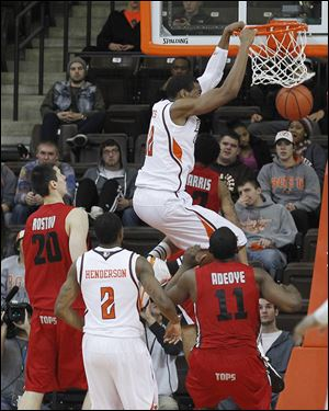 BG's Richaun Holmes dunks in the second half at the Stroh Center. He scored 18 points for the Falcons.
