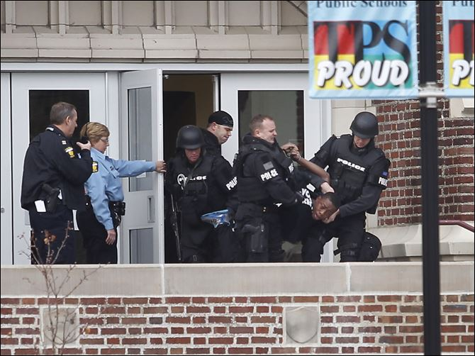 n3scott-2 Toledo police remove Louis Stroude from Scott High School after a standoff.  He reportedly took a pellet gun into the school Monday.
