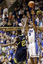 Duke-s-Rodney-Hood-right-shoots-as-Michigan