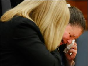 Angela Steinfurth breaks down in tears as she appears before Judge Gary Cook with her attorney Jane Roman.