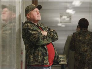 Richard Schiewe, stepfather of Angela Steinfurth, waits for the hearings of his daughter and Steven King, II, to begin.