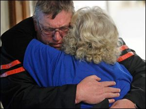 Terry Steinfurth Sr., hugs following the sentencing of Angela Steinfurth. Terry is Elaina's grandfather.