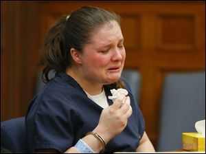 Angela Steinfurth, mother of Elaina Steinfurth, cries during her hearing.