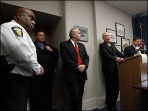 From left:  Toledo Police Chief Derrick Diggs, Capt. Wes Bombrys, Jeff Lingo, chief of the criminal division for the Lucas County Prosecutor's Office, Lucas County Prosecutor Julia Bates, and Lucas County assistant prosecutor Robert Miller speak with the media.