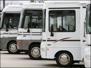 Winnebago motor homes are displayed in Jefferson City, Iowa. During the recession, buyers turned to no-frill travel trailers instead of the pricier stand-alone motor homes. Through October, however, sales of these recreational vehicles were up 36 percent from the same 10-month period last year.