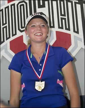 Lakota junior Makayla Dull accepts her medal after winning the Division II state girls title.
