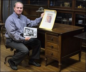 Jade Montrie of Montrie Auction & Estate Service sits at the desk of Mildred Wirt Benson, author of the Nancy Drew mysteries. The desk and other items are from the estate of Margaret �