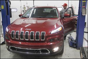 Mechanic Joe Ziegler prepares a 2014 Cherokee for the sales lot at Yark Jeep in Toledo.