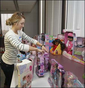 Nikki Newman, 22, of Perrysburg, sorts donated toys as part of their education class' service