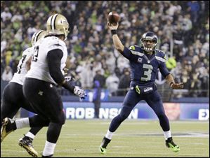 Seattle Seahawks quarterback Russell Wilson (3) throws against the New Orleans Saints in the first half .