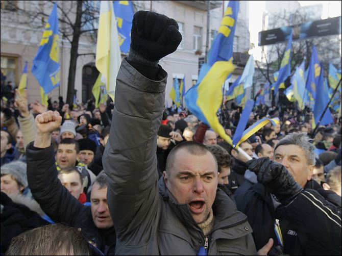 n4ukraine Protesters chant slogans outside the Parliament in Kiev, Ukraine. The opposition on Tuesday sought a vote of no confidence in the government that failed. Secretary of State John Kerry called off a visit to the country scheduled for this week.