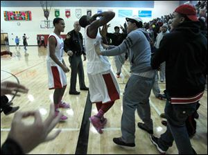 Bowsher's Dajuan King is greeted by fans after his game winning 3-point shot.