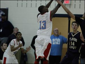 Bowsher's Dajuan King makes the winning 3-point shot.