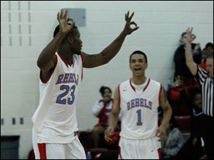Bowsher's Nate Allen signals 3 for his 3-pointer.