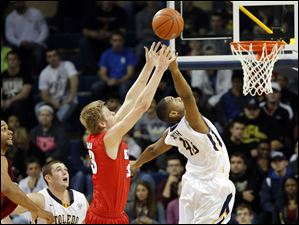 University of Toledo forward Matt Smith (43) knocks the ball away from Detroit forward Evan Bruinsma (33).