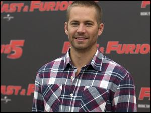 "Paul Walker posing during the photo call of the movie ""Fast and Furious 5,"" in Rome."