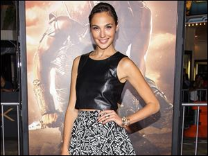 Actress Gal Gadot has been cast as Wonder Woman in Warner Bros. superhero team-up film with Batman and Superman.