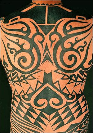 The back portion of a full body tribal style tattoo designed and tattooed by Paul Timman.