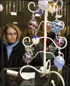 Hand-blown glass ornaments are typical of the arts and crafts that will be available at  Heralding the Holiday events at Toledo Botanical Garden this weekend.
