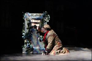 Ebenezer Scrooge, played by Paul Causman, receives a glimpse of his destiny.