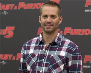 Paul Walker posing during the photo call of the movie