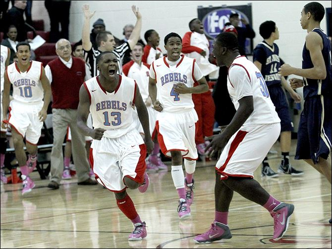 SPT bowsher04p Dajuan King (13) hit a 3-pointer as time expired as the Rebels beat St. John's Jesuit on Tuesday night at