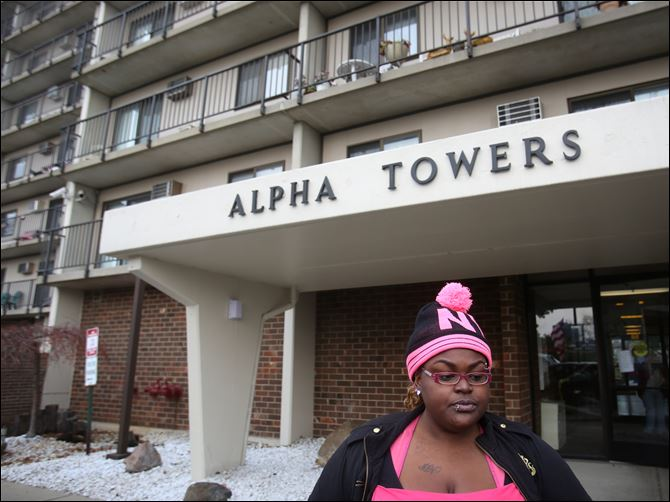 alpha04p Donetta Hayes, a resident at the Alpha Towers housing complex near downtown Toledo, described her frustration at being barred from the building. The complex, which houses many senior citizens, evacuated its residents on the evening of Monday, Dec. 2, 2013, after a malfunction triggered the fire suppression system throughout the building.