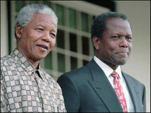 In this May 17, 1996 photo, South African President Nelson Mandela, left, and actor Sidney Poitier appear at a news conference in Cape Town. Poitier is in South Africa making a film in which he portrays Mandela, alongside Michael Caine, who plays former President F. W. de Klerk in