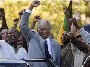 In this image released by Warner Bros., Morgan Freeman portrays Nelson Mandela in a scene from,