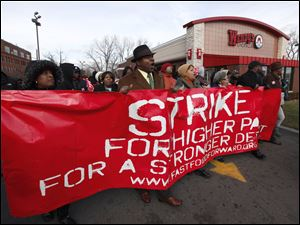 Protesters rally for better wages at a fast-food restaurant in Detroit last month.