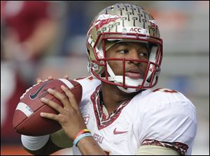 Florida State quarterback Jameis Winston warms up before a game on Saturday.