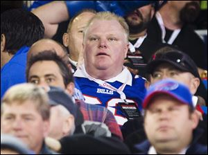 Toronto Mayor Rob Ford watches the Buffalo Bills play the Atlanta Falcons in Toronto Sunday.