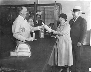 Mr. and Mrs. George Lumley attend a liquor store opening on Huron Street. Liquor stores had to be state-owned until the 1990s.