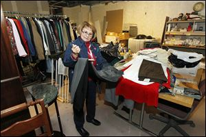 Volunteer Mary Pat Perry organizes the clothing donations Wednesday while working in the ReTail Shop, a new thrift store to help fund organization operations for the Toledo Area Humane Society.