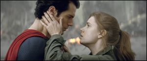 Henry Cavill as Superman, left, and Amy Adams as Lois Lane in 'Man of Steel.'