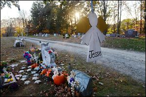 Toy soldiers, rubber ducks, teddy bears, and ceramic stars grace the gravesite of Jesse Lewis in Newtown, Conn.