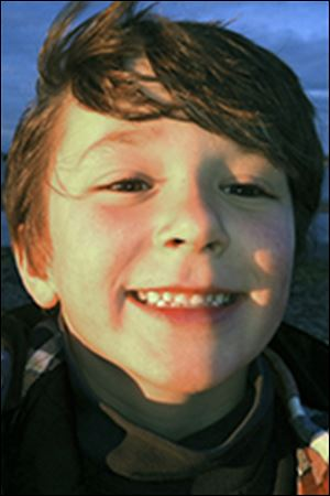 This autumn 2011 photo provided by the Jesse Lewis Choose Love Foundation shows Jesse Lewis, who was slain in the shooting at Sandy Hook Elementary School on Dec. 14, 2012, in Newtown, Conn. Jesse's mother Scarlett Lewis said Friday, Oct. 18, 2013, that Jesse yelled for classmates to run when the gunman paused to reload during the shooting spree. The gunman then shot the boy in the head. Scarlett Lewis said investigators detailed the events inside her sonís classroom after gathering accounts from children who survived. (AP Photo/Jesse Lewis Choose Love Foundation, Scarlett Lewis)