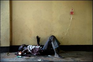 A severely wounded man lies unattended in a Bangui mosque, Bangui, Central African Republic, today following a day-long gun battle between Seleka soldiers and Christian militias.