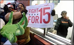 Demonstrators protest for higher wages outside a McDonalds restaurant in Chicago.