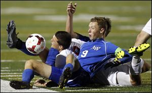 Anthony Wayne's JJ Fortner (9) collides with  Mentor's Brock Venman (9) during a Division I boys state soccer semifinal Wednesday, Nov. 6, 2013, at Perkins High School in Sandusky, Ohio. Mentor defeated Anthony Wayne 1-0.