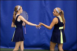 Notre Dame Academy doubles partners Teagan McNamara (left) and Alicia Nahhas celebrate a point during action of the Ohio High School Athletic Association's 38th Annual Girl's State Tennis Tournament.