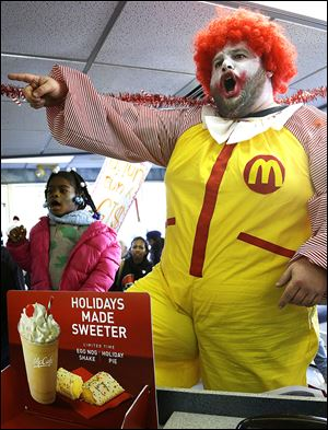 Protesters chant inside a McDonald's restaurant in Oakland, Calif. Protests were held nationwide as unions and worker advocacy groups as well as Democrats renewed a drive for an increase in the federal minimum wage.