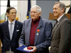At center Robert Zonneville accepts the Medal of Knight of the Legion of Honor.