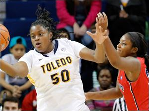 University of Toledo center Brianna Jones (50) comes up with a loos ball against Detroit  forward DeVonna Bradford (33).